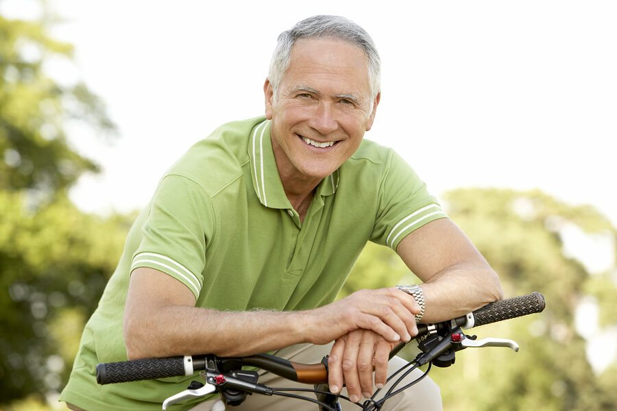 senior man riding cycle
