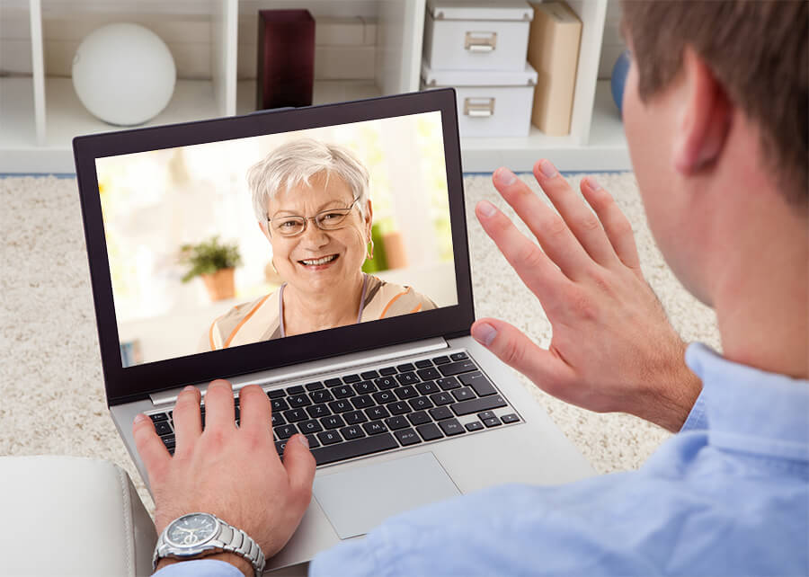 man video chatting with his elderly mother