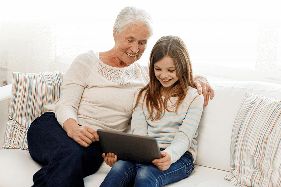 grandmother and granddaughter use tablet